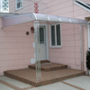 Clear Polycarbonate Patio Awning with Trellises in Elmont