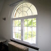 Before and After Inside Round-Top and Casement Windows with Colonial Grids in Jamaica